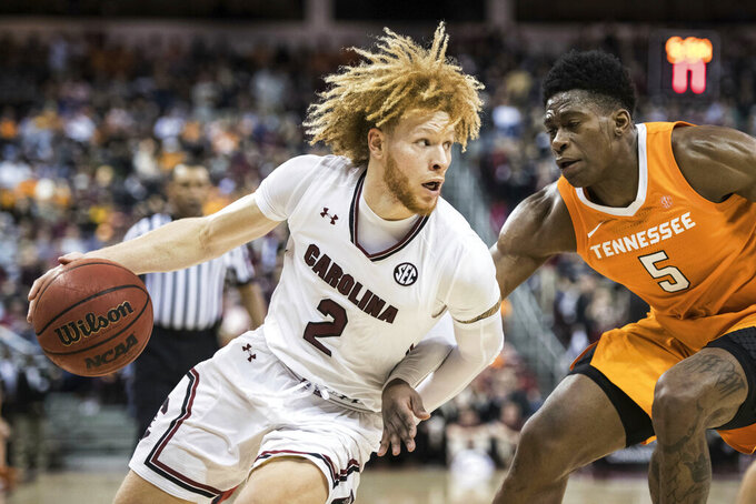 South Carolina guard Hassani Gravett (2) drives to the hoop against Tennessee guard Admiral Schofield (5) during the first half of an NCAA college basketball game Tuesday, Jan. 29, 2019, in Columbia, S.C. Tennessee defeated South Carolina 92-70. (AP Photo/Sean Rayford)
