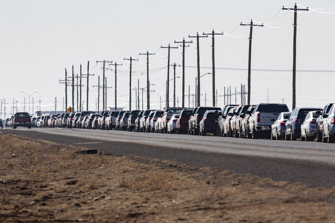 Motorists wait in line for the second dose of the Pfizer COVID-19 vaccine on Texas Loop 338 during the first day of the second dose vaccinations at the Ratliff Stadium Mass Vaccination Site on Tuesday, March 2, 2021 in Odessa, Texas.  (Jacob Ford/Odessa American via AP)