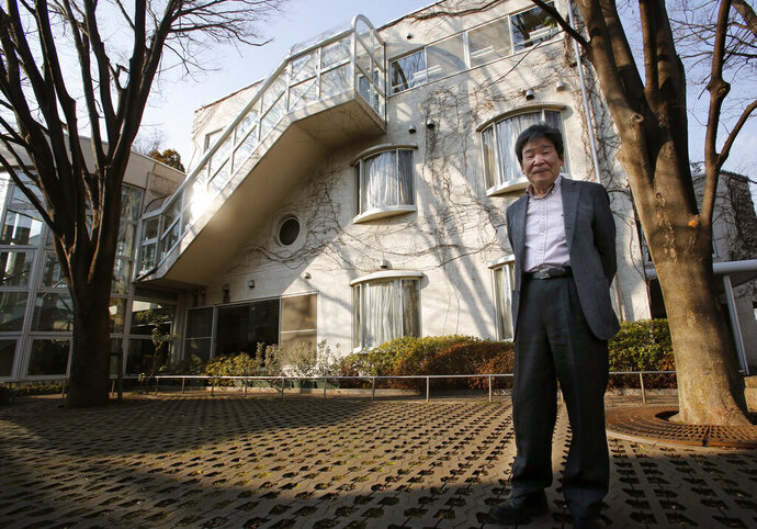 FILE - In this Feb. 12, 2015 file photo, co-founder of Japan's prestigious Studio Ghibli, Isao Takahata, stands in front of his office at Studio Ghibli in suburban Tokyo after an interview about his animated film