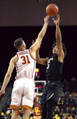 Colorado guard D'Shawn Schwartz, right, shoots as Southern California forward Nick Rakocevic defends during the first half of an NCAA college basketball game Saturday, Feb. 9, 2019, in Los Angeles. (AP Photo/Mark J. Terrill)