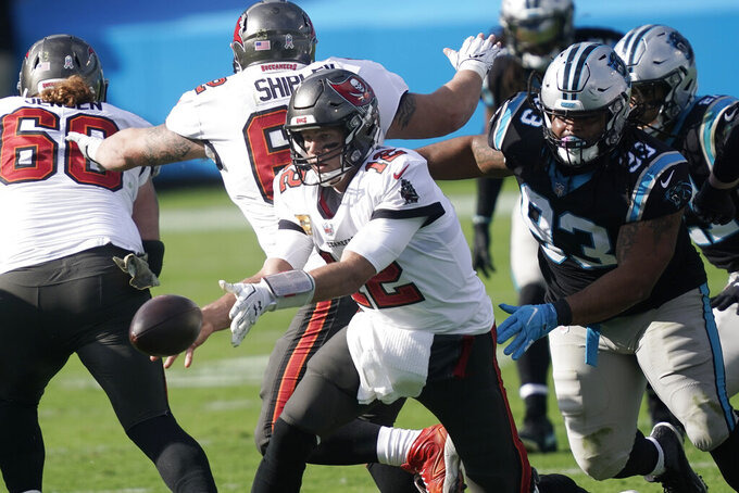 Tampa Bay Buccaneers quarterback Tom Brady (12) works as Carolina Panthers defensive tackle Bravvion Roy (93) defends during the first half of an NFL football game, Sunday, Nov. 15, 2020, in Charlotte , N.C. (AP Photo/Gerry Broome)