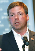 In this June 21, 2019 file photograph, Rep. Robert Foster, R-Hernando, a candidate for the Republican nomination for governor, speaks at the annual Mississippi Press Association Candidates Forum in Biloxi, Miss. Foster recently said he would not let a woman journalist follow him while campaigning unless she was accompanied by a male colleague. Larrison Campbell with the online publication Mississippi Today says she requested to