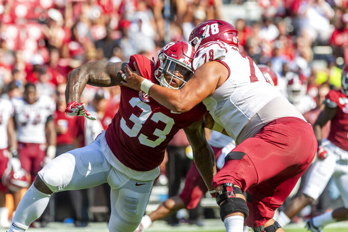 Alabama linebacker Anfernee Jennings (33) battles New Mexico State offensive lineman Brian Trujillo (78) during the first half of an NCAA college football game Saturday, Sept. 7, 2019, in Tuscaloosa, Ala. (AP Photo/Vasha Hunt)