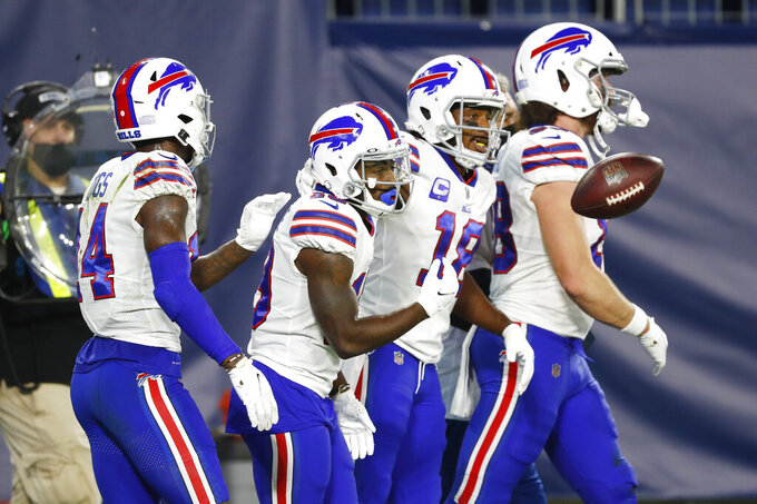 Buffalo Bills wide receiver Isaiah McKenzie, second from left, is congratulated after catching a touchdown pass against the Tennessee Titans in the first half of an NFL football game Tuesday, Oct. 13, 2020, in Nashville, Tenn. (AP Photo/Wade Payne)