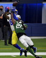 New York Jets free safety Marcus Maye (20) knocks a pass away against tight end Los Angeles Rams' Gerald Everett (81) on fourth down in the second half of an NFL football game in Inglewood, Calif., Sunday, Dec. 20, 2020. (Keith Birmingham/The Orange County Register via AP)