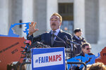 """FILE - In this March 26, 2019, file photo former California Gov. Arnold Schwarzenegger speaks at a rally calling for """"Fair Maps"""" at the Supreme Court in Washington. In California its last Republican governor, Arnold Schwarzenegger, passed a2008ballot measure creating a nonpartisan commission. (AP Photo/Carolyn Kaster, File)"""