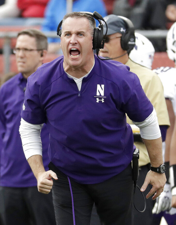 FILE - In this Oct. 20, 2018, file photo, Northwestern head coach Pat Fitzgerald talks to his team during the first half of an NCAA college football game against Rutgers, in Piscataway, N.J. With the Big Ten West title wrapped up, No. 24 Northwestern could coast through the final two games, but coach Pat Fitzgerald isn't having it. The Wildcats play this week at Minnesota, where the Gophers need one more win for bowl-game eligibility. (AP Photo/Julio Cortez, File)
