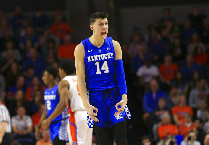 Kentucky guard Tyler Herro celebrates after making a three-point basket against Florida during the first half of an NCAA college basketball game Saturday, Feb. 2, 2019, in Gainesville, Fla. (AP Photo/Matt Stamey)