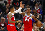 Sacramento Kings' Kent Bazemore, left, and Buddy Hield celebrate in the closing moments of the Kings' 122-102 win over the San Antonio Spurs in an NBA basketball game in Sacramento, Calif., Saturday, Feb. 8, 2020. (AP Photo/Rich Pedroncelli)