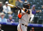 San Francisco Giants' Brandon Crawford follows the flight of his two-run home run off Colorado Rockies relief pitcher Jesus Tinoco in the sixth inning of a baseball game Monday, July 15, 2019, in Denver.(AP Photo/David Zalubowski)