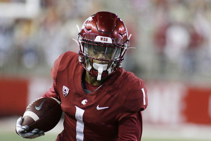 Washington State wide receiver Travell Harris (1) carries the ball during the second half of the team's NCAA college football game against Oregon in Pullman, Wash., Saturday, Nov. 14, 2020. Oregon won 43-29. (AP Photo/Young Kwak)