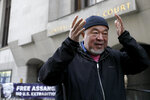 Chinese contemporary artist and activist Ai Weiwei after he conducts a silent protest outside the Old Bailey in support of Julian Assange's bid for freedom during his extradition hearing, in London, Monday, Sept. 28, 2020. (AP Photo/Kirsty Wigglesworth)