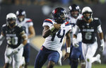 FILE - In this Oct. 7, 2017, file photo, Arizona quarterback Khalil Tate runs for a touchdown past Colorado linebacker Drew Lewis, back left, and defensive back Evan Worthington in the second half of an NCAA college football game, in Boulder, Colo. Colorado is hoping to contain Tate after the Arizona quarterback set an FBS record with 327 yards rushing last season. (AP Photo/David Zalubowski, File)