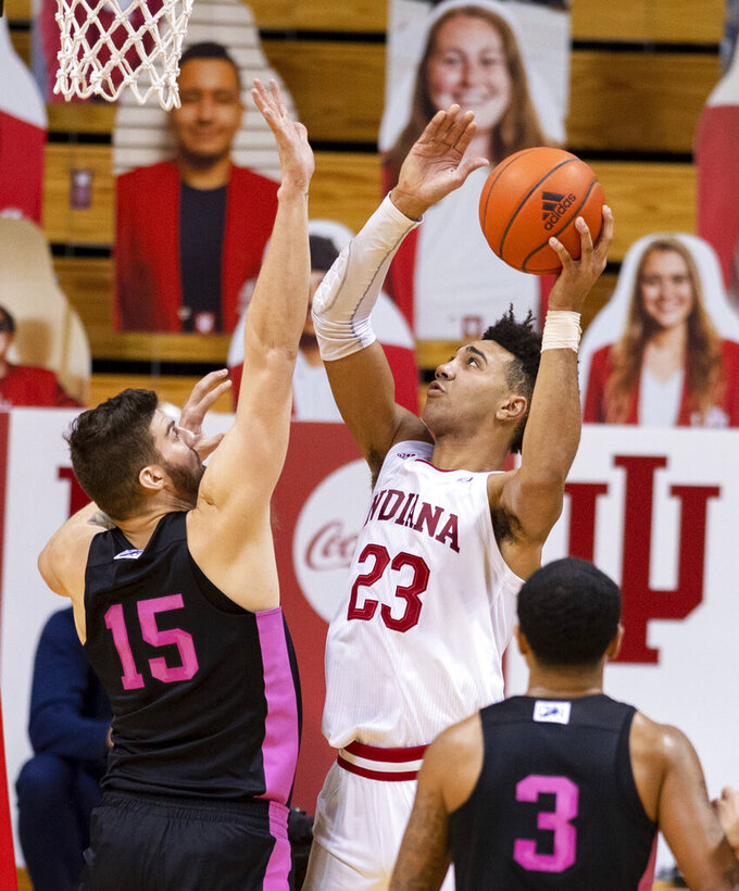 Indiana forward Trayce Jackson-Davis (23) puts up a shot as he's defended by Penn State forward Trent Buttrick (15) during the first half of an NCAA college basketball game, Wednesday, Dec. 30, 2020, in Bloomington, Ind. (AP Photo/Doug McSchooler)
