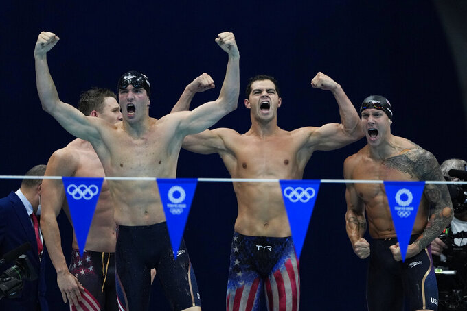 The United States' men's 4x100-meter medley relay team, Caeleb Dressel, Zach Apple, Ryan Murphy and Michael Andrew, celebrate winning the gold medal at the 2020 Summer Olympics, Sunday, Aug. 1, 2021, in Tokyo, Japan. (AP Photo/Gregory Bull)