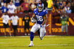 New York Giants running back Saquon Barkley (26) running downfield with the ball against the Washington Football Team during the first half of an NFL football game, Thursday, Sept. 16, 2021, in Landover, Md. (AP Photo/Alex Brandon)