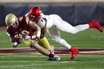 Louisville linebacker C.J. Avery (9) tackles Boston College tight end Hunter Long (80) during the first half of an NCAA college football game, Saturday, Nov. 28, 2020, in Boston. (AP Photo/Michael Dwyer)