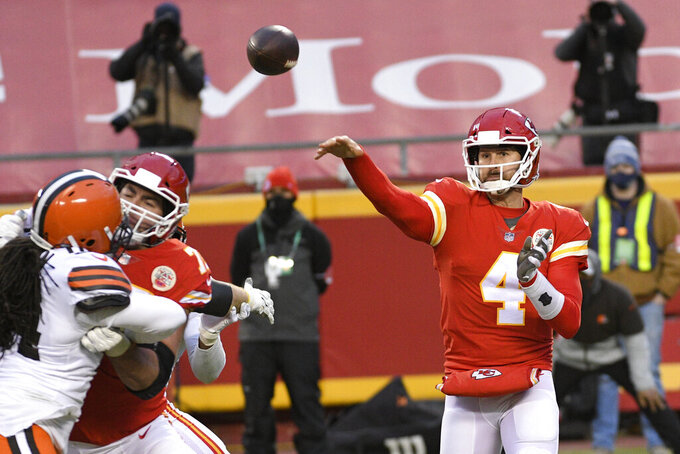 Kansas City Chiefs quarterback Chad Henne throws a pass during the second half of an NFL divisional round football game against the Cleveland Browns, Sunday, Jan. 17, 2021, in Kansas City. The Chiefs won 22-17. (AP Photo/Reed Hoffmann)