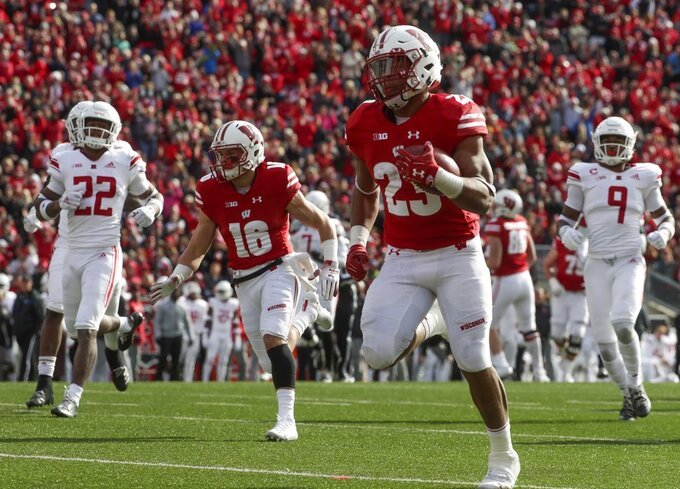 Wisconsin's Jonathan Taylor runs for a touchdown during the second half of an NCAA college football game against Rutgers Saturday, Nov. 3, 2018, in Madison, Wis. (AP Photo/Morry Gash)