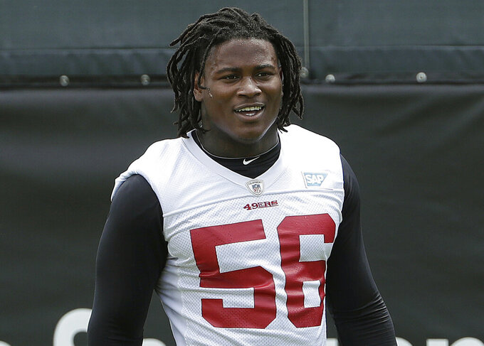 FILE - In this May 30, 2018, file photo, then-San Francisco 49ers linebacker Reuben Foster walks on the field during a practice at the team's NFL football training facility in Santa Clara, Calif. Foster has been fined two game checks and reinstated to the Washington Redskins' active roster after an NFL investigation found he did not violate the league's personal conduct policy. The league announced Foster's punishment and new status Friday, April 12, 2019. (AP Photo/Jeff Chiu, File)