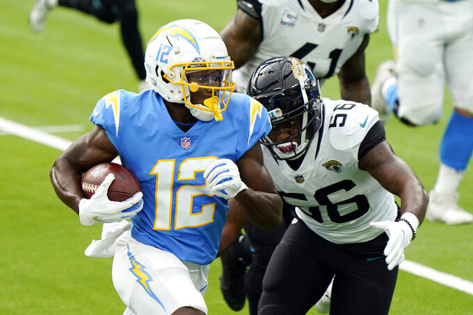 Los Angeles Chargers' Joe Reed (12) runs for a touchdown past Jacksonville Jaguars linebacker Quincy Williams (56) during the first half of an NFL football game Sunday, Oct. 25, 2020, in Inglewood, Calif. (AP Photo/Alex Gallardo )