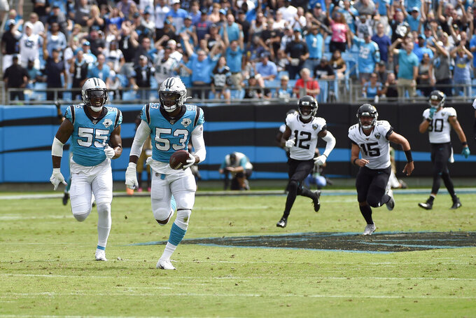 Carolina Panthers linebacker Brian Burns (53) runs for a touchdown following a fumble during the first half of an NFL football game against the Jacksonville Jaguars in Charlotte, N.C., Sunday, Oct. 6, 2019. (AP Photo/Mike McCarn)