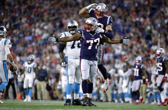 New England Patriots defensive end Michael Bennett (77) celebrates his sack of Carolina Panthers quarterback Kyle Allen in the first half of an NFL preseason football game, Thursday, Aug. 22, 2019, in Foxborough, Mass. (AP Photo/Elise Amendola)