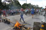 Relatives protest for more information, outside the Anisio Jobim Prison Complex where a deadly riot erupted among inmates in the northern state of Amazonas, Brazil, Sunday, May 26, 2019. A statement from the state prison secretary says prisoners began fighting among themselves around noon Sunday, and security reinforcements were rushed to complex. (AP Photo/Edmar Barros)