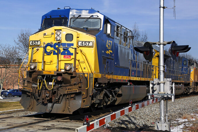 FILE - In this Feb. 12, 2018, file photo a CSX freight train passes through Homestead, Pa.  CSX Corp. said its first-quarter profit declined 8% as expenses increased, but the railroad said it expects the economy to strengthen further over the rest of the year. The Jacksonville, Florida-based company said Tuesday, April 20, 2021, that it earned $706 million, or 93 cents per share, during the quarter.  (AP Photo/Gene J. Puskar, File)