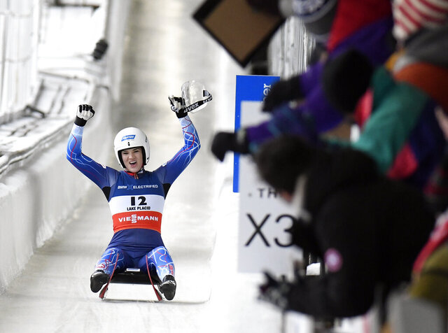 Summer Britcher, of the United States, celebrates a second-place finish in the women's sprint World Cup luge event in Lake Placid, N.Y., on Sunday, Dec. 1, 2019. (AP Photo/Hans Pennink)