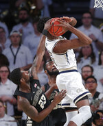 Georgia Tech forward Moses Wright (5) has his shot blocked by Wake Forest guard Chaundee Brown (23) during the first half of an NCAA college basketball game, Saturday, Jan. 5, 2019, in Atlanta. (AP Photo/John Bazemore)