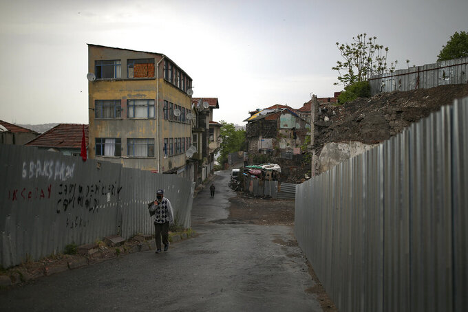 """A person walks in Fatih neighborhood, during a strict lockdown to help curb the spread of the coronavirus, in Istanbul, Saturday, May 8, 2021. The """"full lockdown,"""" which began in late April and will last until May 17 came amid a huge surge in infections. (AP Photo/Emrah Gurel)"""