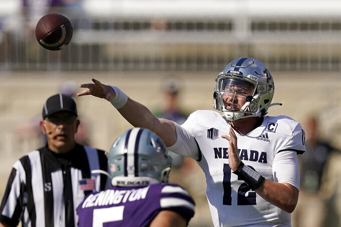 Nevada quarterback Carson Strong passes the ball during the second half of an NCAA college football game against Kansas State Saturday, Sept. 18, 2021, in Manhattan, Kan. (AP Photo/Charlie Riedel)