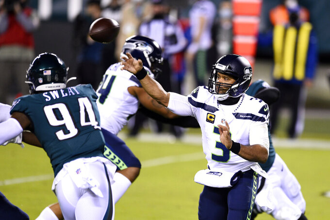 Seattle Seahawks' Russell Wilson passes during the first half of an NFL football game against the Philadelphia Eagles, Monday, Nov. 30, 2020, in Philadelphia. (AP Photo/Derik Hamilton)