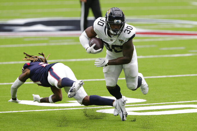 Jacksonville Jaguars running back James Robinson (30) runs against the Houston Texans during the first half of an NFL football game Sunday, Oct. 11, 2020, in Houston. (AP Photo/Michael Wyke)