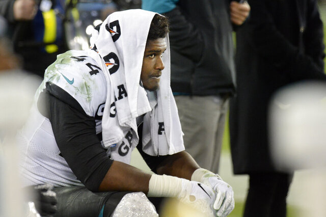 Jacksonville Jaguars linebacker Myles Jack sits on the bench late in the fourth quarter of an NFL football game against the Tennessee Titans Sunday, Nov. 24, 2019, in Nashville, Tenn. The Titans won 42-20. (AP Photo/Mark Zaleski)