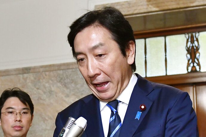 Japanese Trade Minister Isshu Sugawara speaks after a cabinet meeting at parliament in Tokyo Friday, Oct. 25, 2019. A report says Sugawara has offered his resignation on Friday after his office was accused of violating election laws. (Yoshitaka Sugawara/Kyodo News via AP)