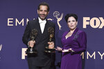 Tony Shaloub, left, poses with the award for outstanding supporting actor in a comedy series, and Alex Borstein, right, poses with the award for outstanding supporting actress in a comedy series for