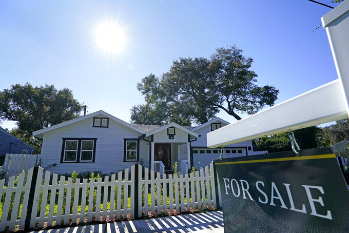 A home for sale is seen Tuesday, Dec. 8, 2020, in Orlando, Fla. U.S. long-term mortgage rates again rose modestly the week of March 8, 2021, against the backdrop of an improving economy and further distribution of coronavirus vaccines. Rates remain near historic lows, however. (AP Photo/John Raoux)
