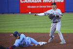 New York Yankees second baseman Tyler Wade throws to first after forcing out Toronto Blue Jays Cavan Biggio' out on a ball hit by Lourdes Gurriel Jr., who was out on the double play during the second inning of a baseball game Thursday, June 17, 2021, in Buffalo, N.Y. (AP Photo/Jeffrey T. Barnes)