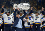 FILE- In this June 12, 2019, file photo, St. Louis Blues head coach Craig Berube carries the Stanley Cup after the Blues defeated the Boston Bruins in Game 7 of the NHL Stanley Cup Final in Boston. (AP Photo/Michael Dwyer, File)
