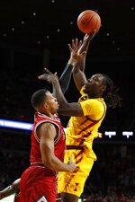 Iowa State forward Solomon Young shoots over Northern Illinois forward Lacey James, left, during the first half of an NCAA college basketball game, Tuesday, Nov. 12, 2019, in Ames, Iowa. (AP Photo/Charlie Neibergall)