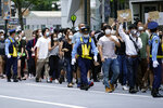People march to protest during a solidarity rally for the death of George Floyd and against racism Saturday, June 6, 2020, in Tokyo. Floyd died after being restrained by Minneapolis police officers on May 25. (AP Photo/Eugene Hoshiko)