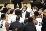 Cleveland State head coach Dennis. Gates celebrates with is team following an NCAA college basketball game in the men's Horizon League conference tournament championship game against Oakland, Tuesday, March 9, 2021, in Indianapolis. Cleveland State won 80-69 (AP Photo/Darron Cummings)