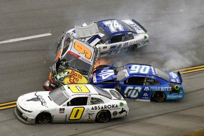 Noah Gragson (9), Caesar Bacarella (9), Jeffrey Earnhardt (0) and C.J. McLaughlin (74) collide during a NASCAR Xfinity Series auto race Saturday, Oct. 2, 2021, in Talladega, Ala. (AP Photo/Russell Norris)