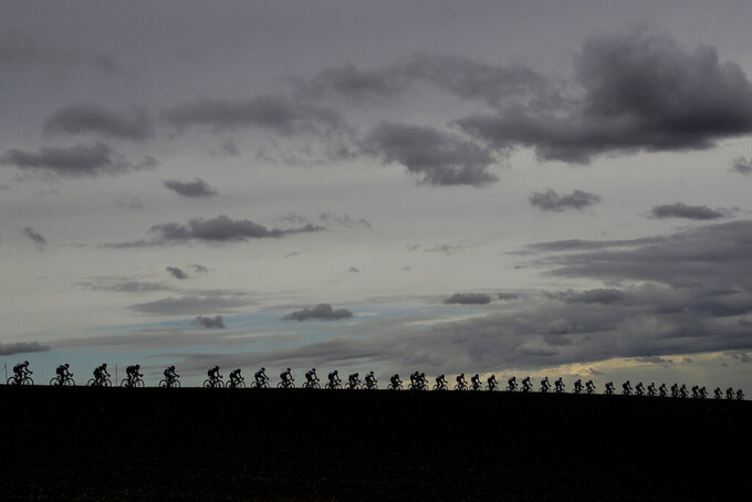 Riders pedal under a cloudy sky during the men's elite event, at the road cycling World Championships, in Imola, Italy, Sunday, Sept. 27, 2020. (AP Photo/Andrew Medichini)