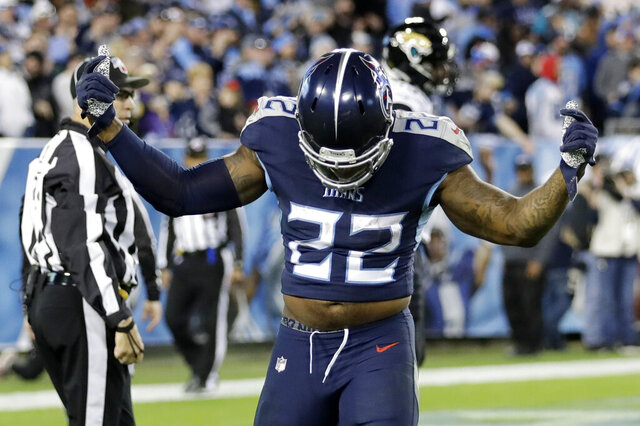 Tennessee Titans running back Derrick Henry celebrates after scoring a touchdown on a 74-yard run against the Jacksonville Jaguars in the second half of an NFL football game Sunday, Nov. 24, 2019, in Nashville, Tenn. (AP Photo/James Kenney)