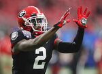 Georgia defensive back Richard LeCounte, who was injured in a motorcycle accident earlier in the season, prepares to play Cincinnati in the NCAA college football Peach Bowl game on Friday, Jan. 1, 2021, in Atlanta. (Curtis Compton/Atlanta Journal-Constitution via AP)