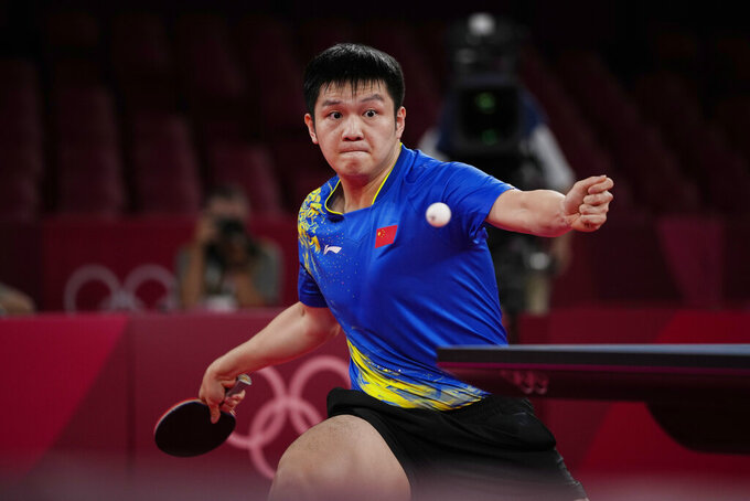 China's Fan Zhendong competes during the table tennis men's singles quarterfinal match against South Korea's Jeoung Young-sik at the 2020 Summer Olympics, Wednesday, July 28, 2021, in Tokyo. (AP Photo/Kin Cheung)