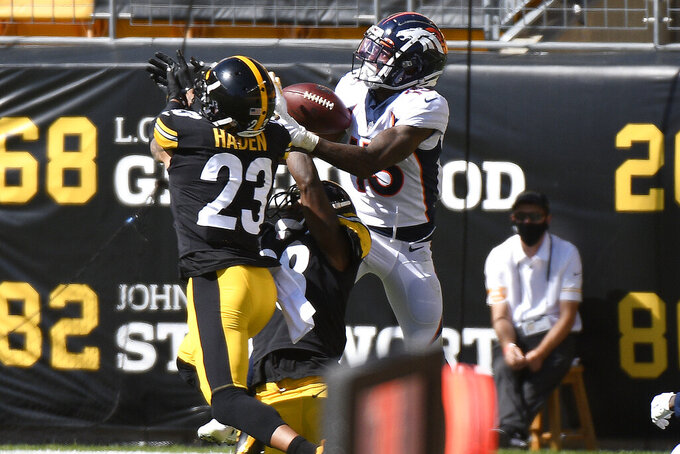 Pittsburgh Steelers cornerback Joe Haden, left, breaks up a pass intended for Denver Broncos wide receiver K.J. Hamler, right, in the end zone during the first half of an NFL football game in Pittsburgh, Sunday, Sept. 20, 2020. (AP Photo/Don Wright)